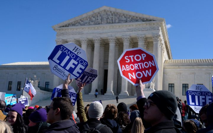 Protesters rally outside of the Supreme Court on March 2 as the court hears oral arguments in Whole Woman's Health v. He