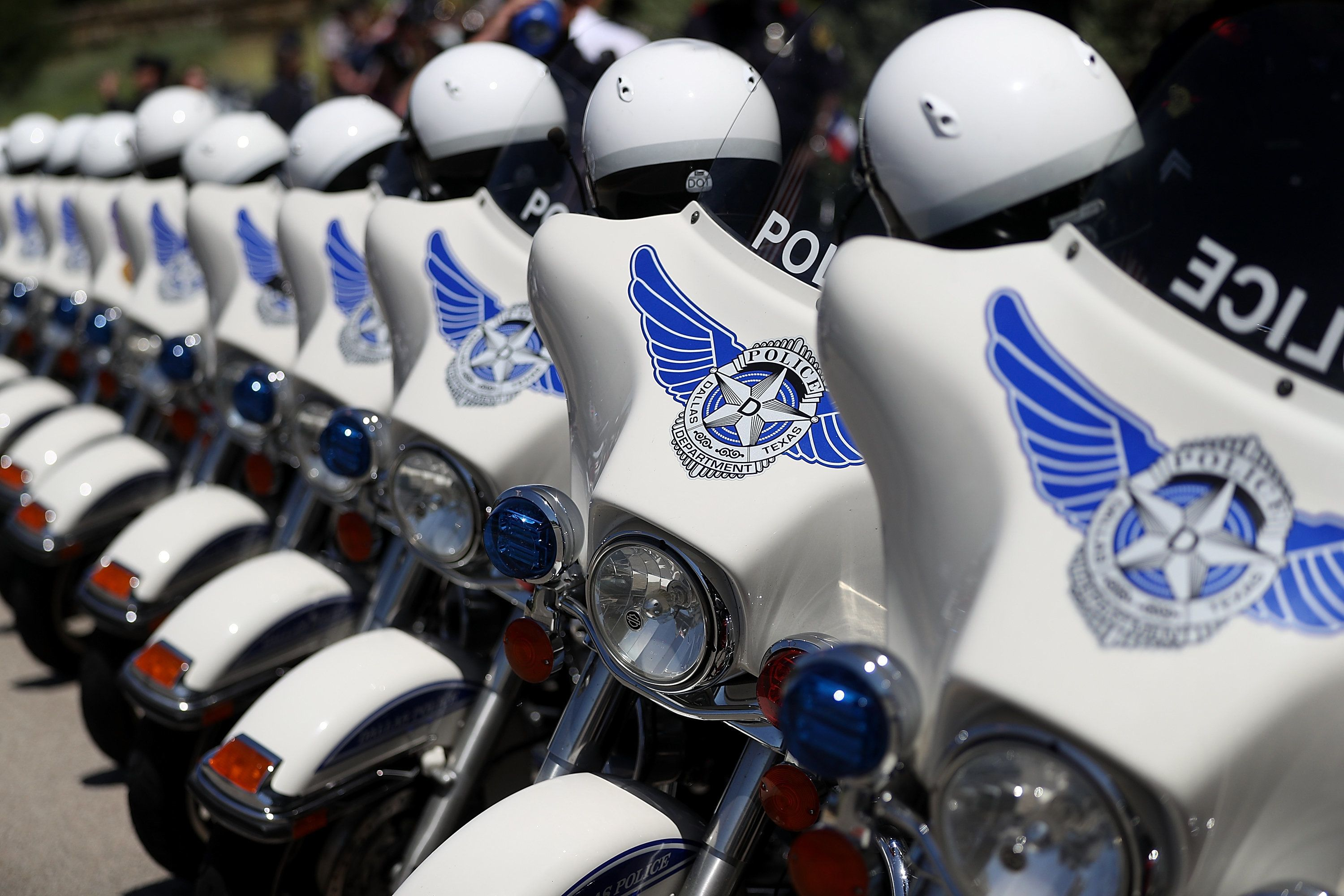Dallas police motorcycles line up outside the funeral for Sgt. Michael Smith, one of those shot by a gunman in July.