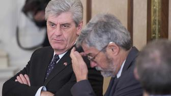 Mississippi Governor Phil Bryant (L) looks on during a meeting of the National Governors Association at the White House in Washington, DC, February 23, 2015.    AFP PHOTO/JIM WATSON        (Photo credit should read JIM WATSON/AFP/Getty Images)