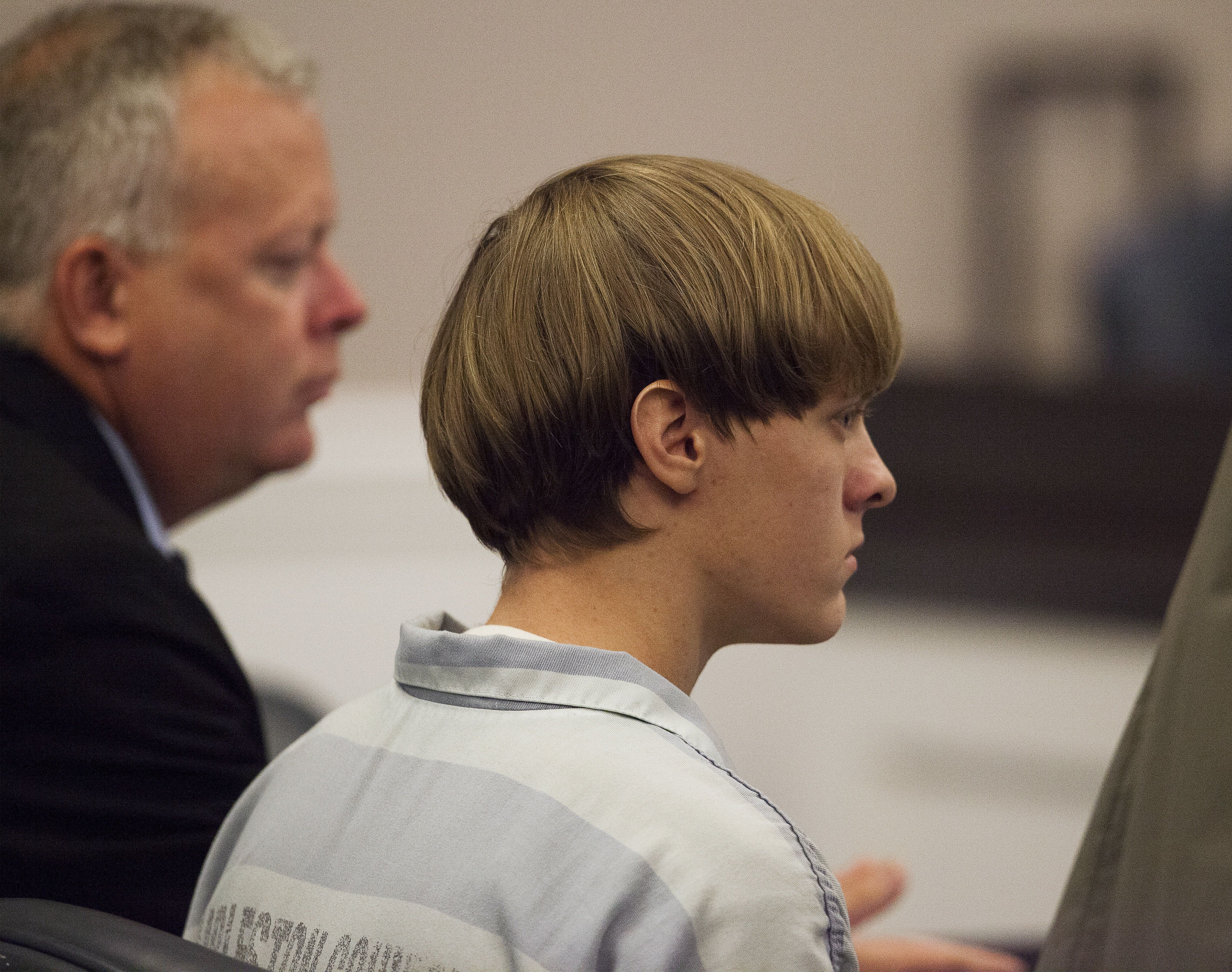 Dylann Roof (R), the 21-year-old man charged with murdering nine worshippers at a historic black church in Charleston last month, listens to the proceedings with assistant defense attorney William Maguire during a hearing at the Judicial Center in Charleston, South Carolina July 16, 2015.   REUTERS/Randall Hill/Files