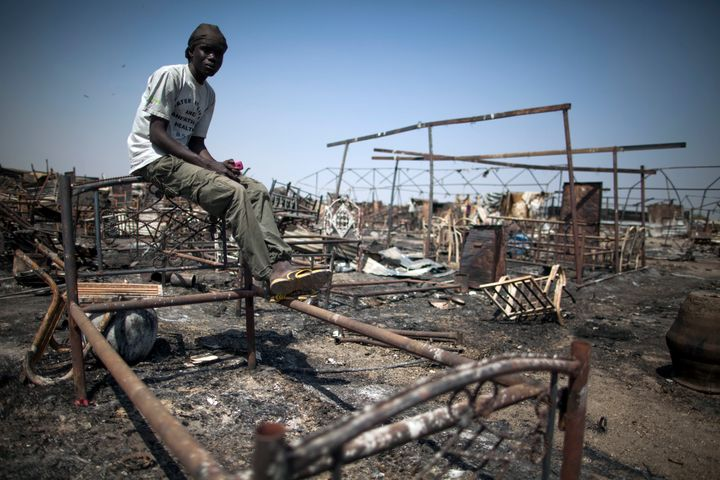 Shaggier Gabriel, a displaced man residing in the United Nations Protection of Civilians (PoC) site in Malakal, South Sudan, sits on his former bed in a burnt and looted area, on Feb. 26, 2016.