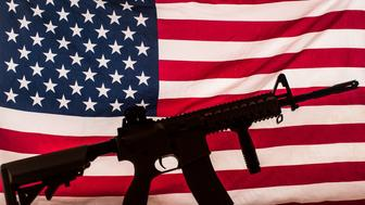 AR-15 type assault rifle silhouette on american flag