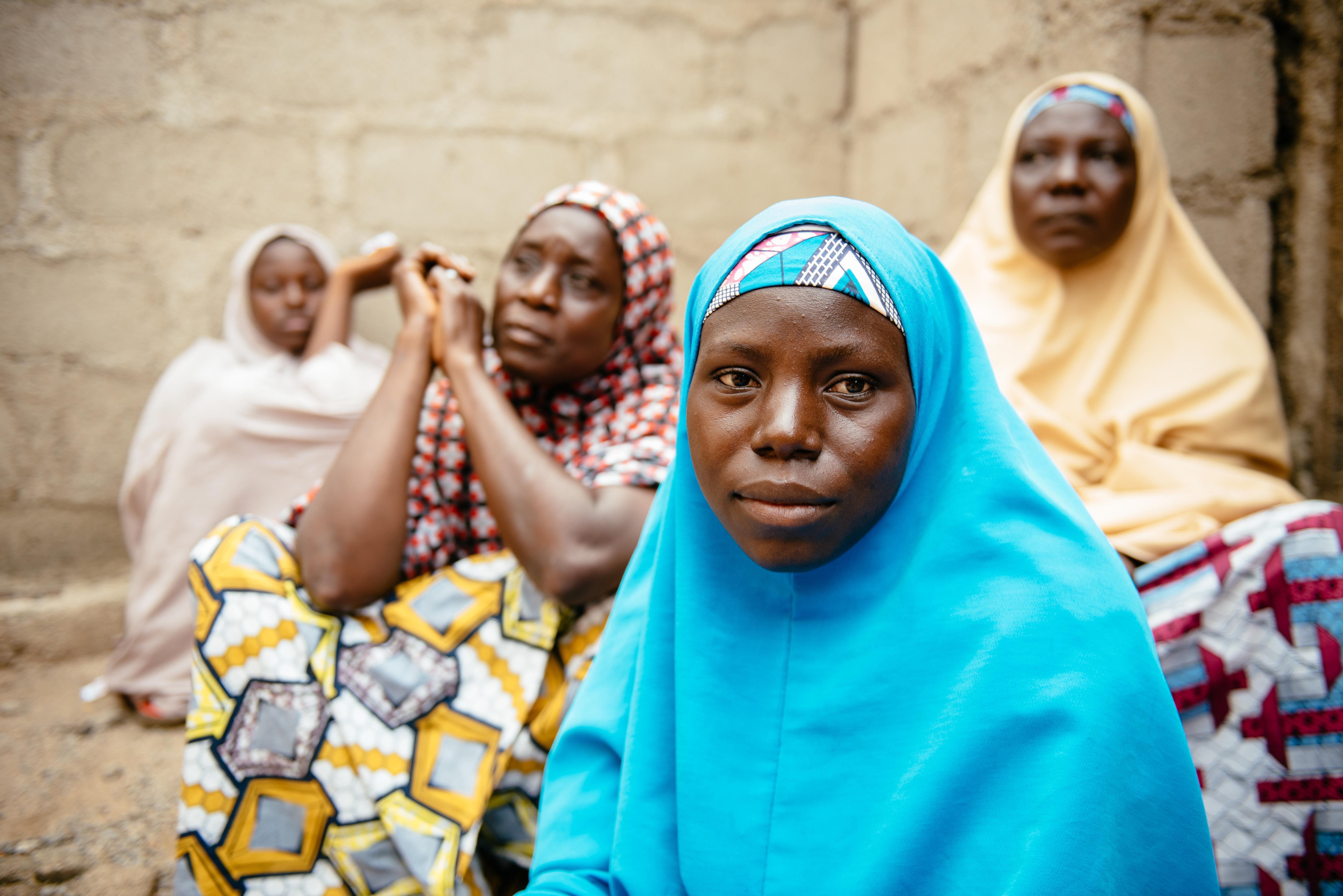 Aisha, 30, (blue hijab) in Biu, Borno State Nigeria. She and her four children were displaced3years ago after Bok