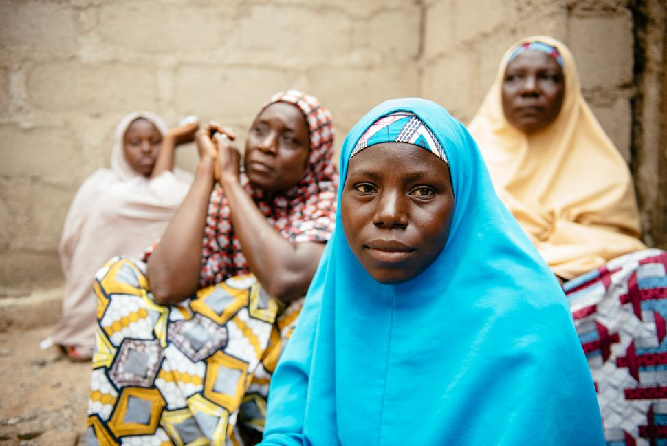 Aisha, 30, (blue hijab) in Biu, Borno State Nigeria. She and her four children were displaced 3 years ago after Bok