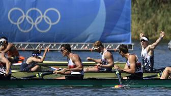 CORRECTION - Britain's Matt Langridge (R) celebrates after winning the Men's Eight final rowing competition at the Lagoa stadium during the Rio 2016 Olympic Games in Rio de Janeiro on August 13, 2016. / AFP / Jeff PACHOUD / The erroneous mention[s] appearing in the metadata of this photo by Jeff PACHOUD has been modified in AFP systems in the following manner: [Britain's Matt Langridge (R)] instead of [Britain's Paul Bennett (R)]. Please immediately remove the erroneous mention[s] from all your online services and delete it (them) from your servers. If you have been authorized by AFP to distribute it (them) to third parties, please ensure that the same actions are carried out by them. Failure to promptly comply with these instructions will entail liability on your part for any continued or post notification usage. Therefore we thank you very much for all your attention and prompt action. We are sorry for the inconvenience this notification may cause and remain at your disposal for any further information you may require.        (Photo credit should read JEFF PACHOUD/AFP/Getty Images)
