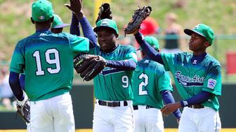 WILLIAMSPORT, PA - AUGUST 21:  Jovan Edaku #9 of the Europe-Africa team from Uganda reacts after a defensive stop during the game against the Caribbean team from the Dominican Republic at Volunteer Stadium during Game 1 of the Little League World Series on Friday, August 21, 2015 in Williamsport, Pennsylvania. (Photo by Alex Trautwig/MLB Photos via Getty Images)