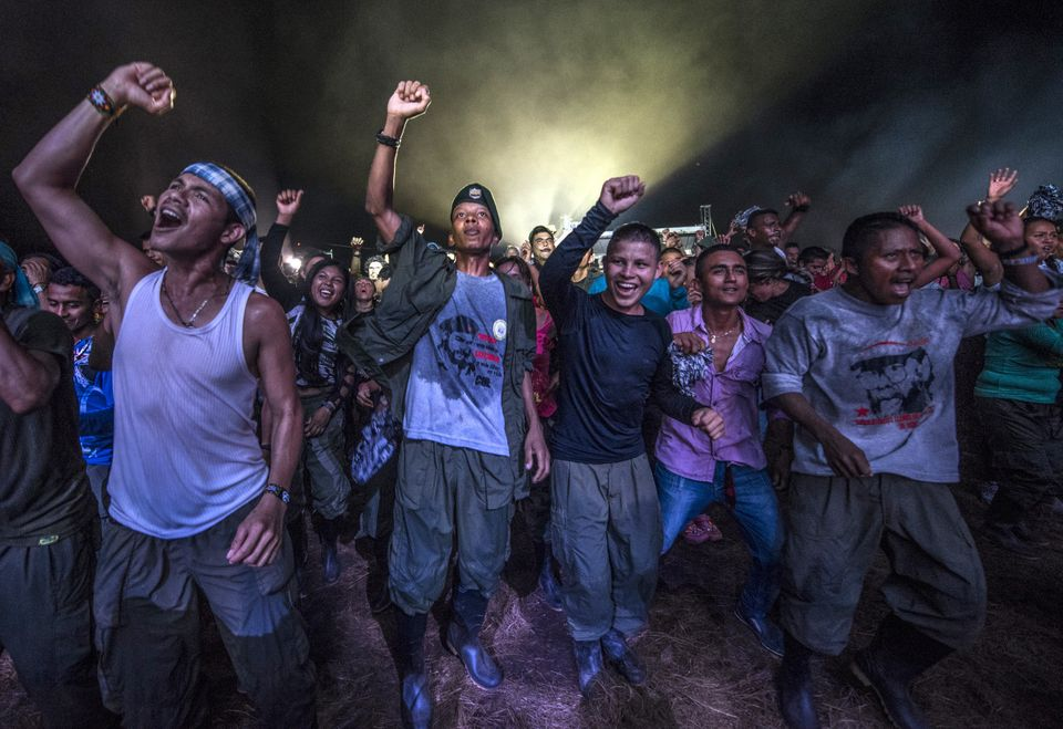 FARC guerrillas dance during an event at their encampment in Llanos del Yari, Colombia, on Sept.