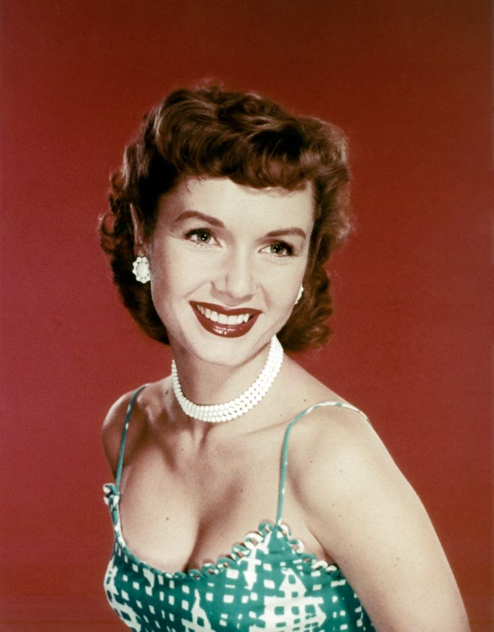 "Debbie Reynolds shot to stardom with her role as Kathy Selden in 1952's ""Singin' in the Rain."" She was also a popular singer,"