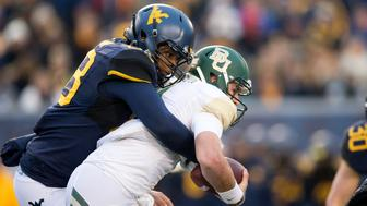 MORGANTOWN, WV - DECEMBER 03: West Virginia Mountaineers DL Adam Shuler II (88) sacks Baylor Bears QB Zach Smith (4) during the first quarter of the game between the Baylor Bears and the West Virginia Mountaineers on December 03, 2016, at Mountaineer Field at Milan Puskar Stadium in Morgantown, WV. West Virginia defeated Baylor 24-21. (Photo by Frank Jansky/Icon Sportswire via Getty Images)