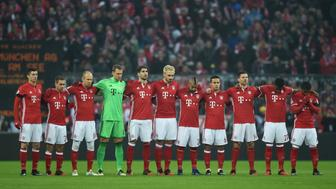 The team players of FC Bayern Munich respect a minute of silence for victims of a terror attack at a christmas market in Berlin prior to the German first division Bundesliga football match FC Bayern Munich vs RB Leipzig in Munich, Germany, on December 21, 2016. / AFP / Christof STACHE / RESTRICTIONS: DURING MATCH TIME: DFL RULES TO LIMIT THE ONLINE USAGE TO 15 PICTURES PER MATCH AND FORBID IMAGE SEQUENCES TO SIMULATE VIDEO. == RESTRICTED TO EDITORIAL USE == FOR FURTHER QUERIES PLEASE CONTACT DFL DIRECTLY AT + 49 69 650050         (Photo credit should read CHRISTOF STACHE/AFP/Getty Images)