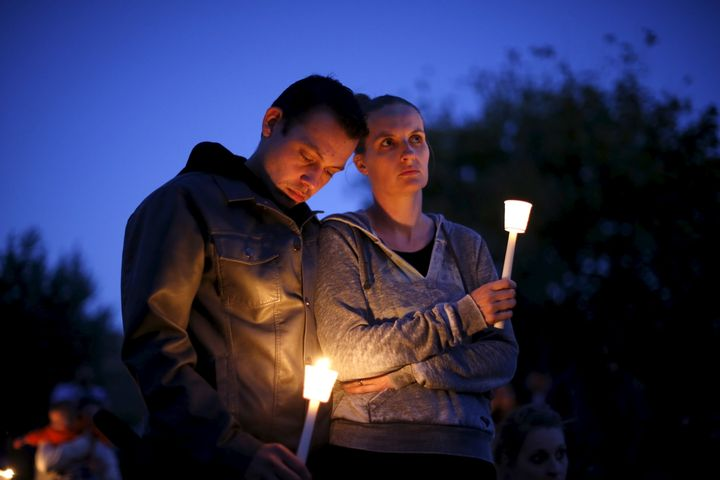 People take part in a candlelight vigil for victims of the Umpqua Community College shooting in Oregon on Oct. 3, 2015.
