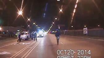 CHICAGO, IL - OCTOBER 20:  In this still image taken from a police vehicle dash camera released by the Chicago Police Department on November 24, 2015 ,  Laquan McDonald walks up a street just prior to being shot by Chicago Police officer Jason Van Dyke on October 20, 2014  in Chicago, Illinois. Officer Van Dyke was charged  with first degree murder for the October 20, 2014 shooting in which McDonald was hit with 16 bullets.  (Photo by  Chicago Police Department via Getty Images)
