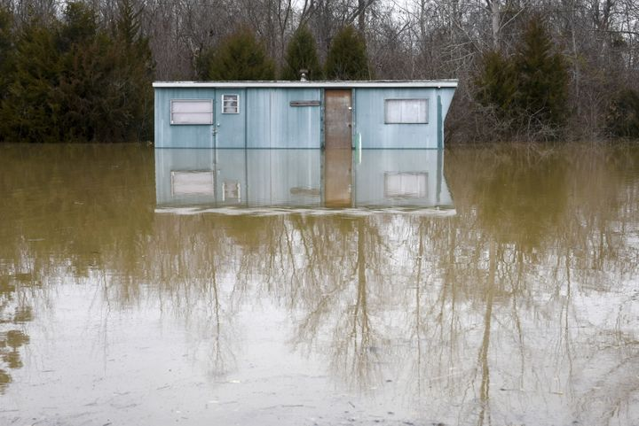 A partially submerged house is seen after several days of heavy rain led to flooding in Arnold, Missouri, December 30, 2015.