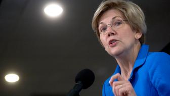 Senator Elizabeth Warren, a Democrat from Massachusetts, speaks during a Roosevelt Institute event at the National Press Club in Washington, D.C., U.S., on Tuesday, May 12, 2015. Warren, who says Wall Street recklessness caused the 2008 financial crisis, and New York Mayor Bill de Blasio, who is seeking to become a national leader for progressives, introduced a study by Joseph Stiglitz suggesting that new regulations could curb the flow of gains to the wealthiest and most powerful. Photographer: Andrew Harrer/Bloomberg via Getty Images
