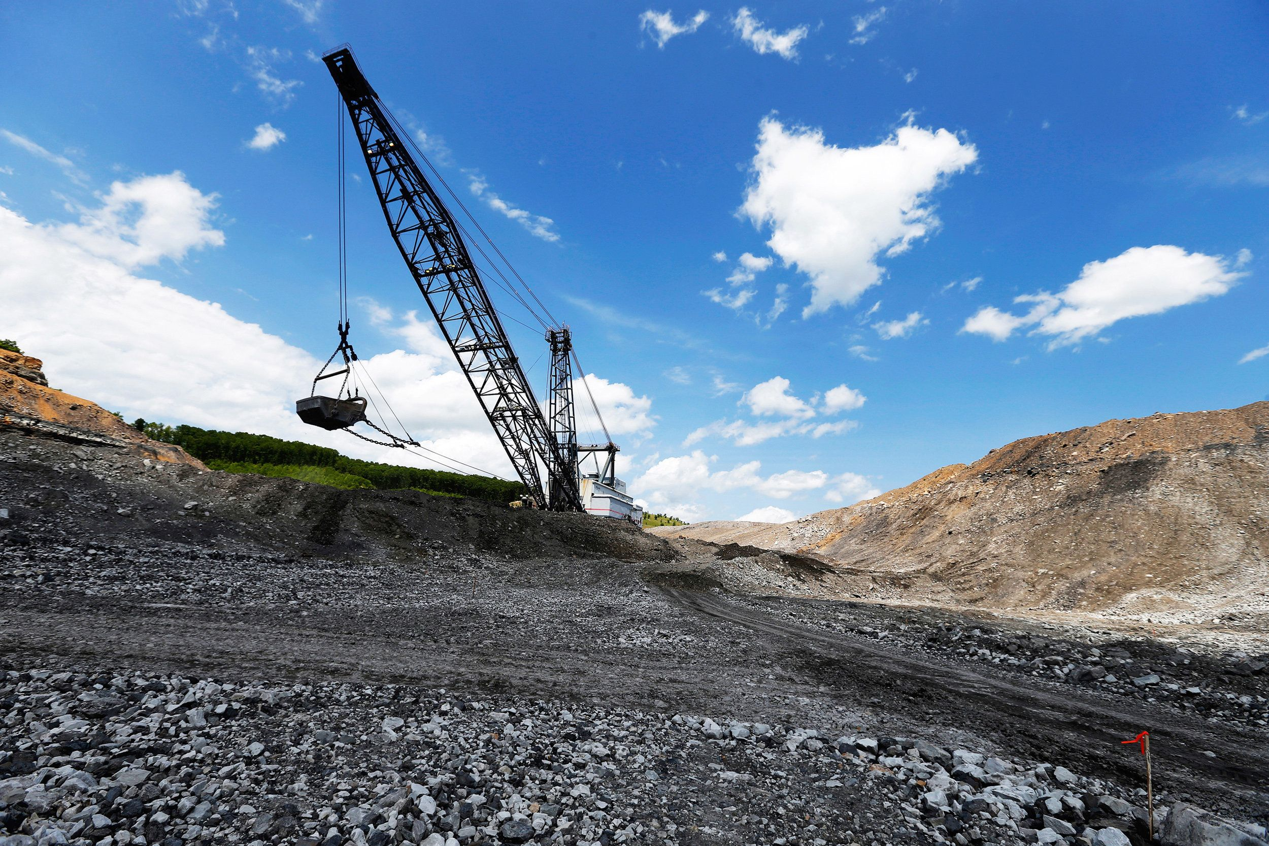 FILE PHOTO --  The massive Big John dragline works to reshape the rocky landscape in some of the last sections to be mined for coal at the Hobet site in Boone County, West Virginia, U.S. May 12, 2016.     REUTERS/Jonathan Ernst/File Photo