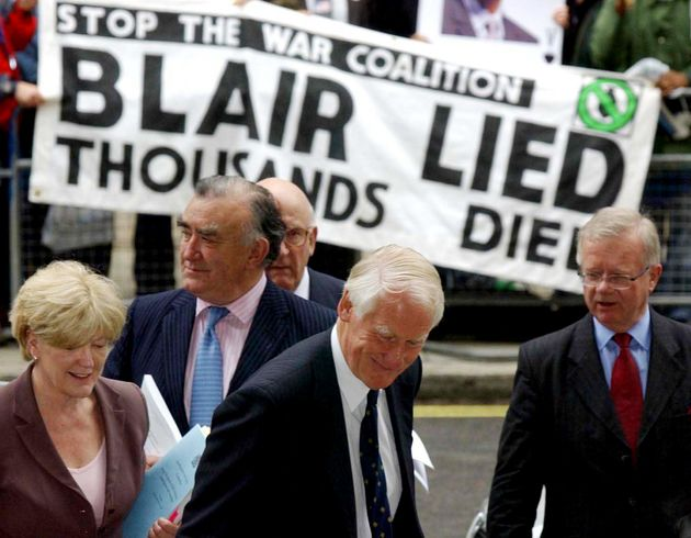 Lord Butler, centre, and his team, from left, Ann Taylor, Michael Mates, Lord Inge and Sir John Chilcott,...