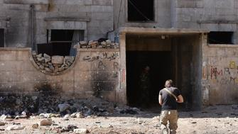A Syrian pro-government soldier runs for cover in the '1070' apartment block area, south of al-Hamdaniyah, in eastern Aleppo on November 4, 2016. Syrian rebels fired rockets at one of the eight evacuation corridors opened from opposition-held east Aleppo during a unilateral Russian-declared ceasefire, Syrian state television reported.   / AFP / GEORGE OURFALIAN        (Photo credit should read GEORGE OURFALIAN/AFP/Getty Images)