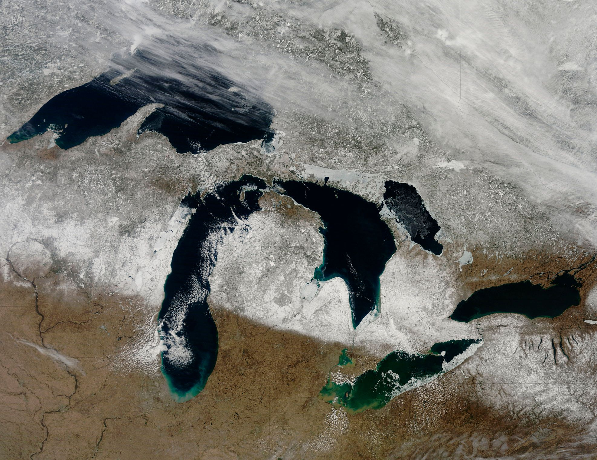 March 28, 2011 - The bright white remnants of snow cut a clean swath across Wisconsin and Michigan during springtime snowmelt. Snow depth in most of the snow-covered swath ranged from 4 inches to 20 inches on the day this image was captured.