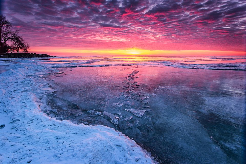 The sun rises over a frozen Lake Erie.