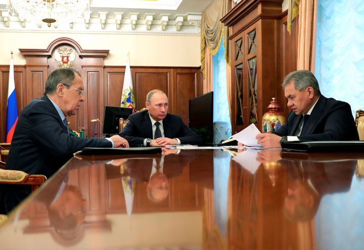Russia's President Vladimir Putin (C), Foreign Minister Sergei Lavrov (L), and Defence Minister Sergei Shoigu attend a meeting at the Kremlin in Moscow.