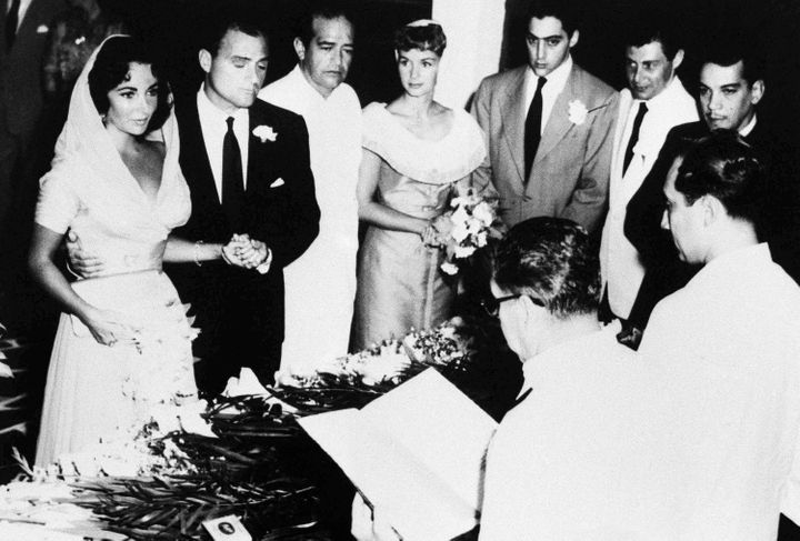 Elizabeth Taylor and Mike Todd wed at a 1957 ceremony in Mexico, with Debbie Reynolds and Eddie Fisher looking on.