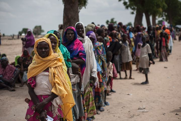 Women and children in the Muna informal settlementfor internally displaced people on the outskirts of Maiduguri, Borno