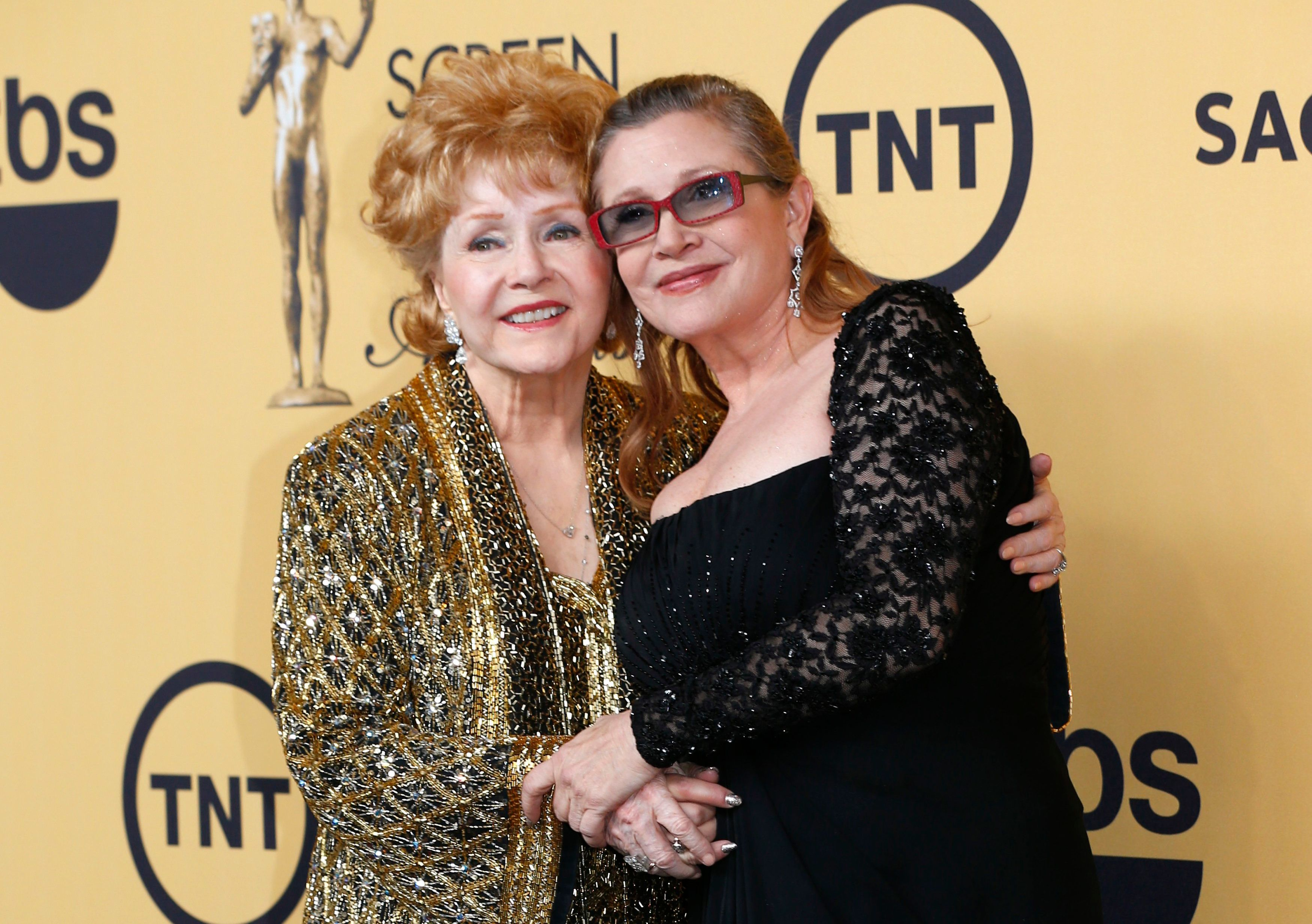 Actress Debbie Reynolds poses with her daughter actress Carrie Fisher backstage after accepting her Lifetime Achievement awar