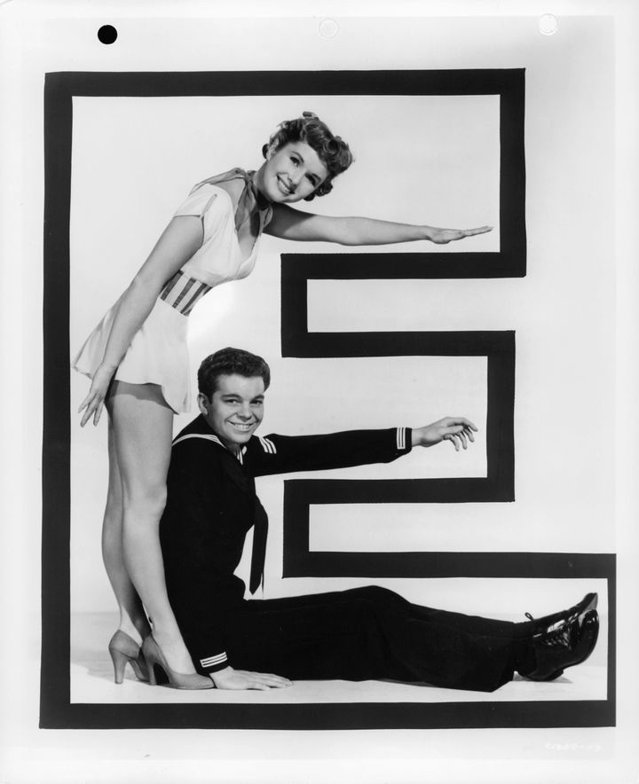"""Debbie Reynolds and Russ Tamblyn in a letter """"E,"""" from the film """"Hit The Deck,"""" 1955."""