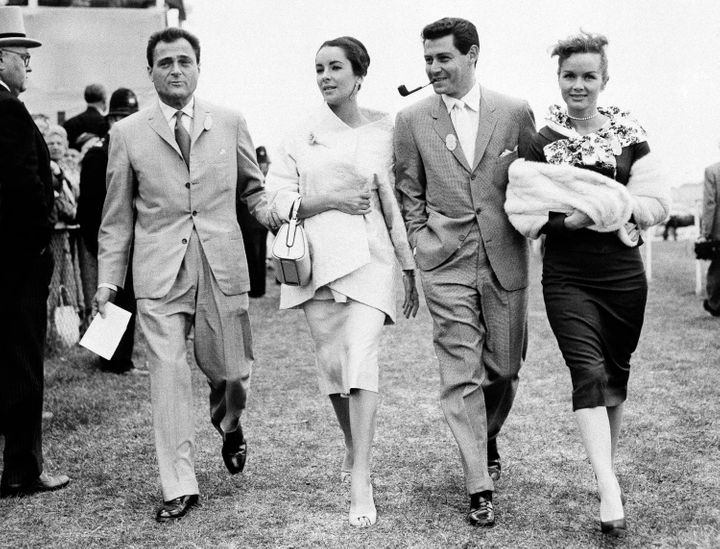 Mike Todd, Elizabeth Taylor, Eddie Fisher and Debbie Reynolds stroll through Epsom Downs on June 5, 1957.