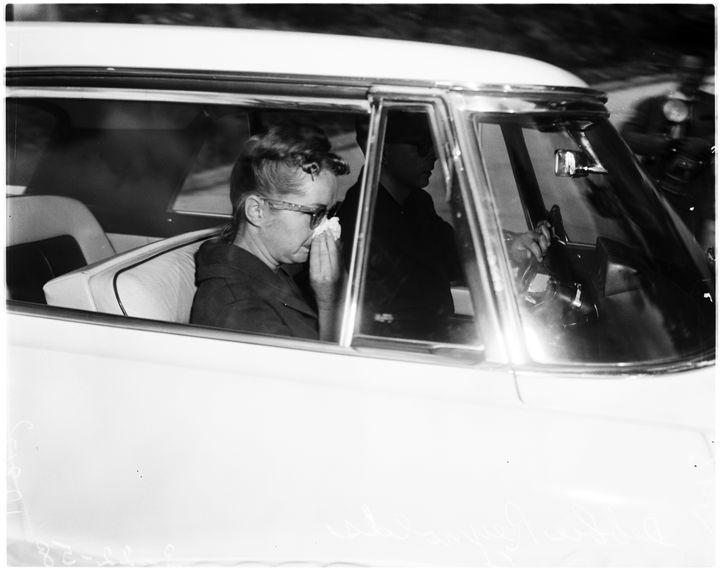 Debbie Reynolds and Eddie Fisher leaveElizabeth Taylor's home after Michael Todd's death.