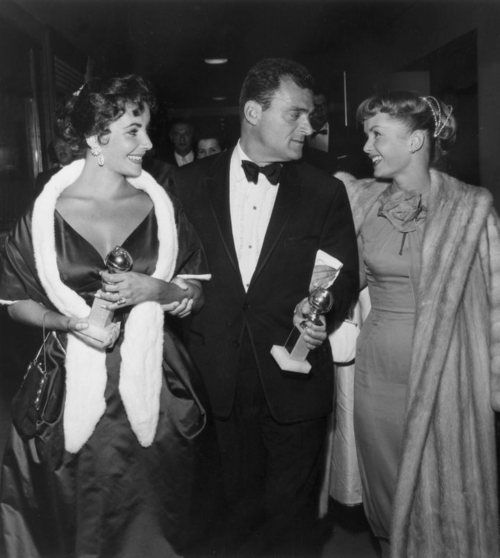 Elizabeth Taylor, Mike Todd and Debbie Reynolds attend the 1958 Golden Globe Awards.