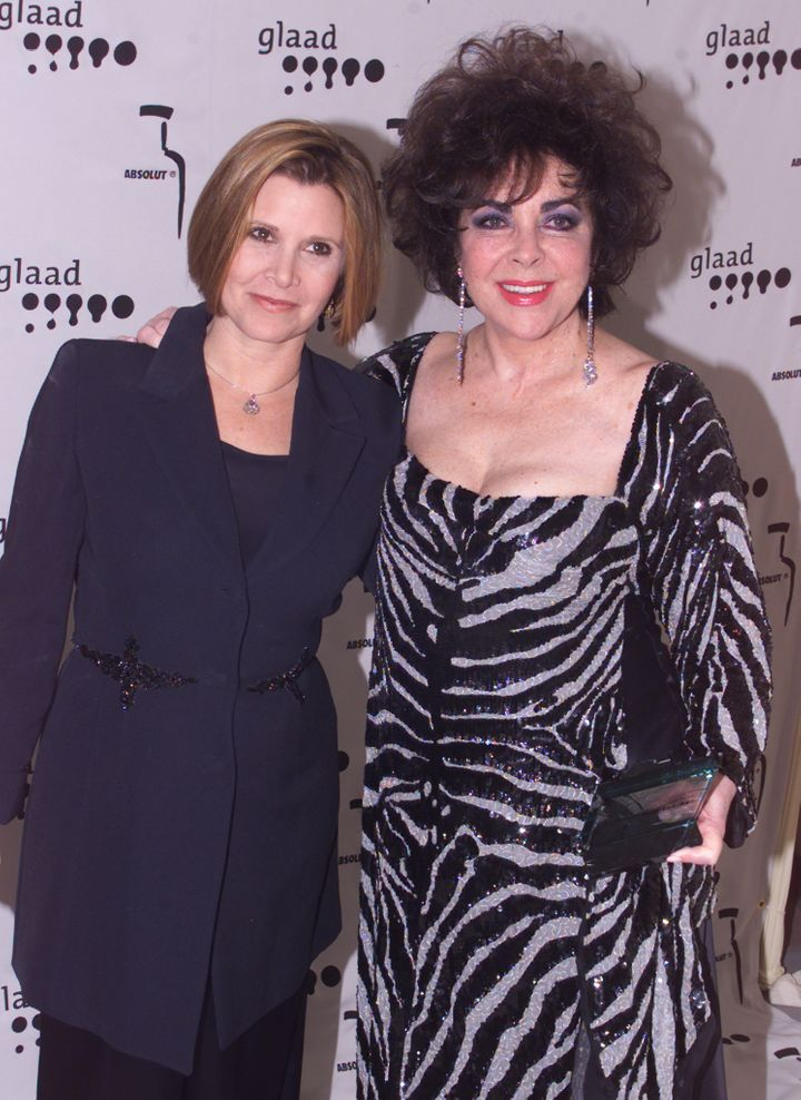 Carrie Fisher and Elizabeth Taylor pose at the 2011 GLADD Awards.