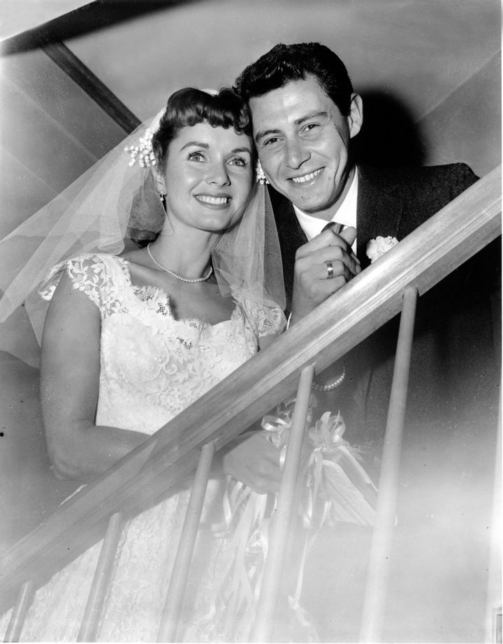 Debbie Reynolds and Eddie Fisher pose after their 1955 marriage ceremony in New York.
