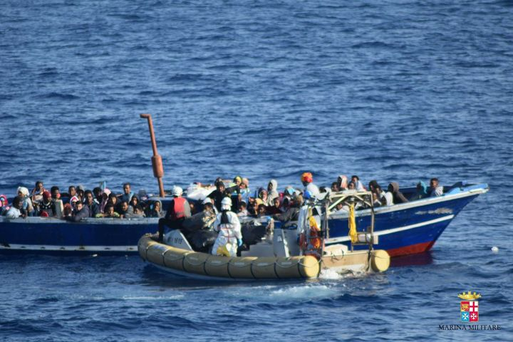 138 Refugees, trying to pass Europe, are seen on a boat at the middle of the Mediterranean Sea before Italian security forces