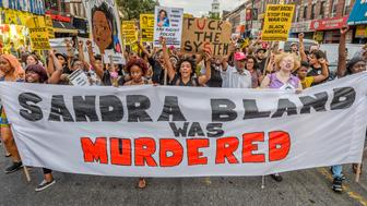 FLATBUSH, BROOKLYN, NEW YORK, UNITED STATES - 2016/07/13: About a thousand Black Lives Matter activists rally at the corner of Church Ave and 18th street in Brooklyn, honoring the life of Sandra Bland exactly one year after she died in police custody after a traffic stop. The rally was followed by a march through the street of Brooklyn to let the community know they are still in the streets, fighting for Sandra Bland and other Black women who were killed by police or who died in police custody. (Photo by Erik Mcgregor/Pacific Press/LightRocket via Getty Images)