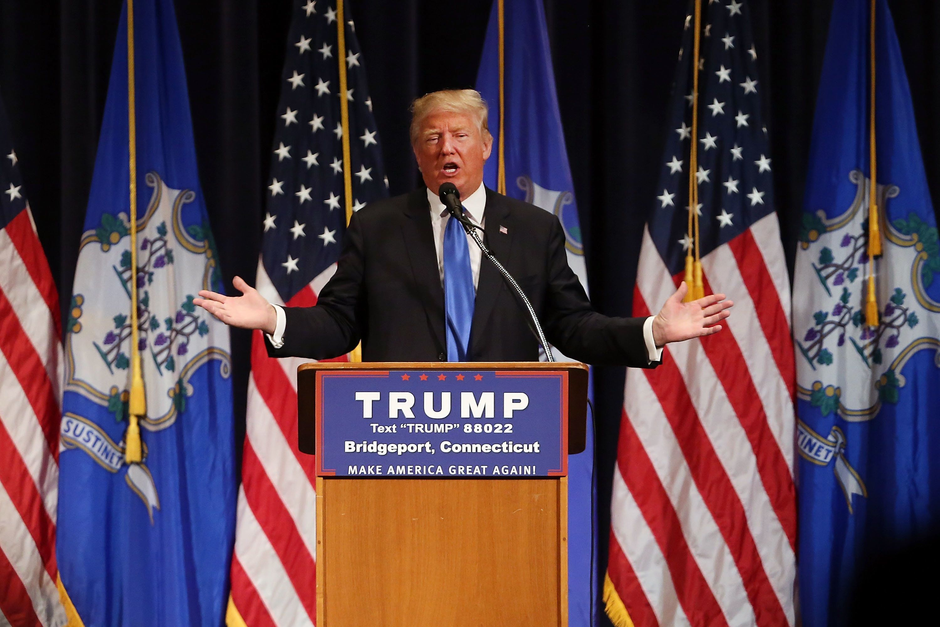 BRIDGEPORT, CT - APRIL 23:  Republican presidential candidate Donald Trump speaks at a rally in Bridgeport on April 23, 2016 in Bridgeport, Connecticut. Under a heavy police presence, the afternoon event was disrupted on a number of occasions by protesters. Despite his advisers pledging that Trump will begin using a more presidential tone in his appearances, in Bridgeport Trump did not use a teleprompter and stuck to his usual style.  (Photo by Spencer Platt/Getty Images)