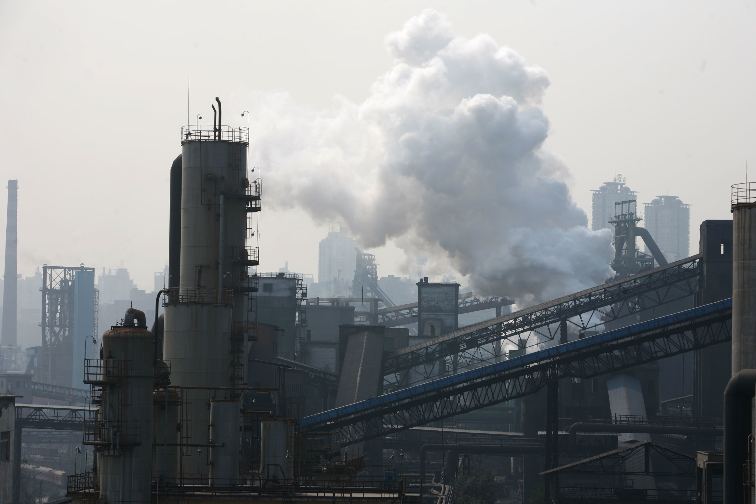 CHONGQING, CHINA - MARCH 1: (CHINA OUT) Smoke billows from steel slags at a plant of Chongqing Iron and Steel (Group) Co., Ltd. on March 1, 2007 in Chongqing Municipality, China. Chongqing Steel will relocate from the city's central to its suburbs by 2012 in line with a government strategy to move manufacturing out of the major cities, according to state media. The relocation program, to start in this May, is environmentally motivated as 50 per cent of city's pollution comes from the Chongqing Steel plants. This move is costing 24 billion yuan (about US$ 3.1 billion). (Photo by China Photos/Getty Images)