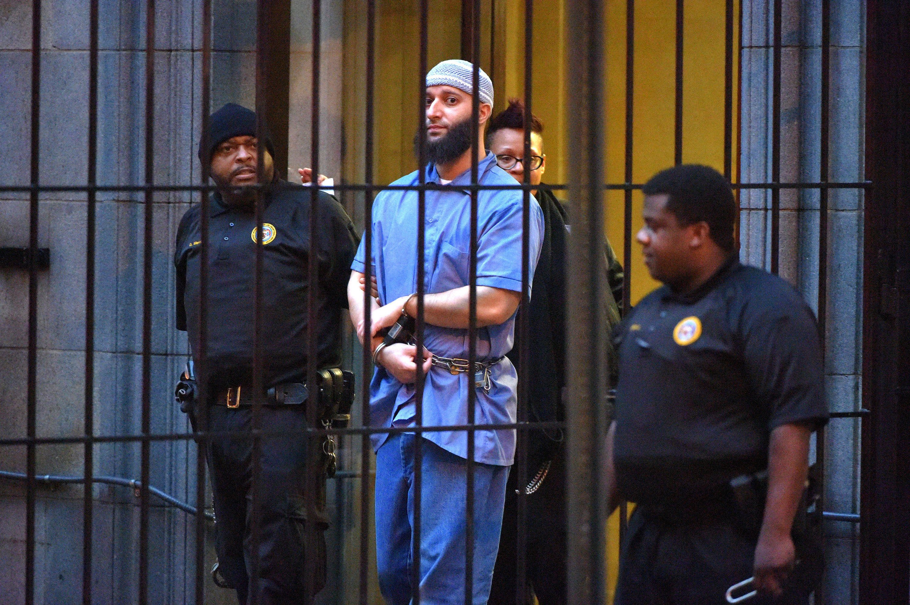 Officials escort Adnan Syed from the courthouse in February 2016. Syed's request to be released on bail...