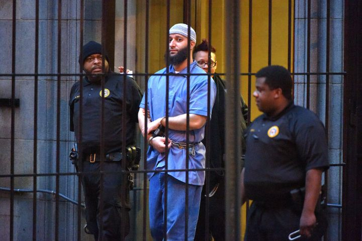 Officials escort Adnan Syed from the courthouse in February 2016. Syed's request to be released on bail was denied Wednesday.