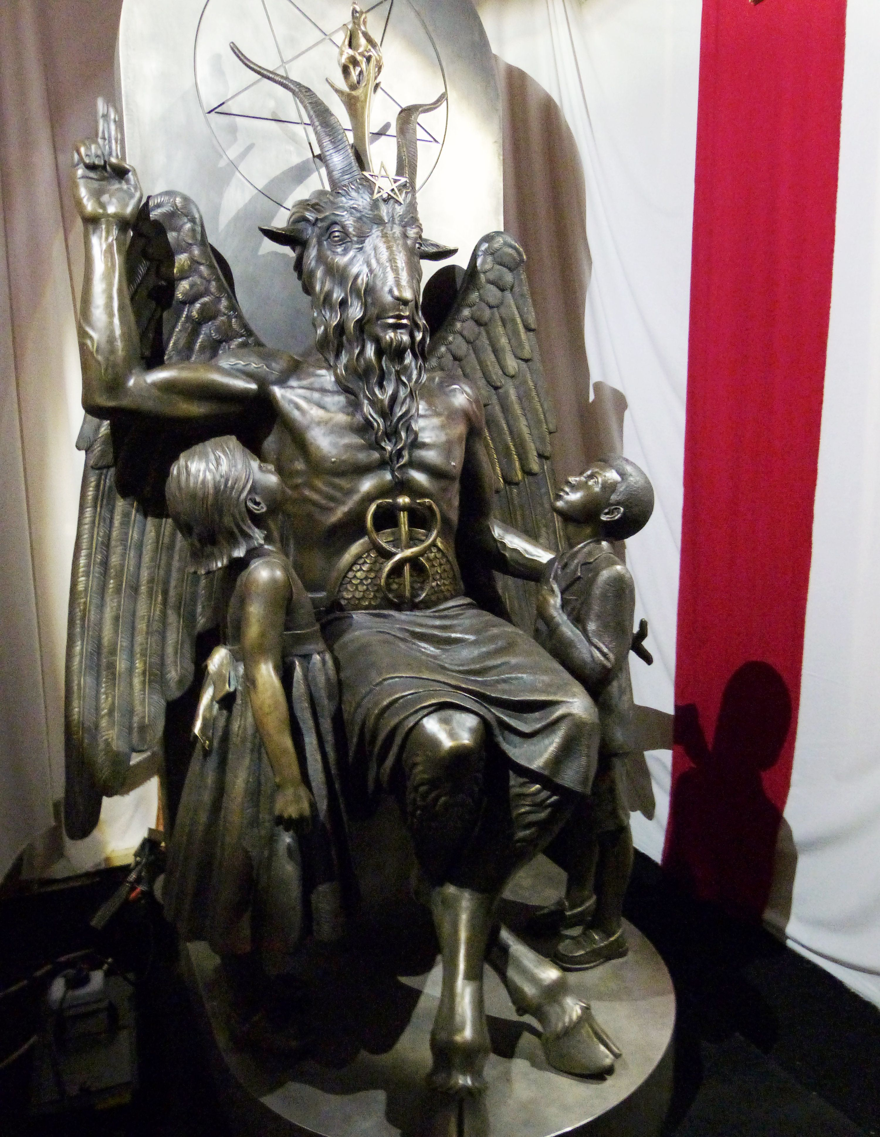 A one-ton, 7-foot (2.13-m) bronze statue of Baphomet -- a goat-headed winged deity that has been associated with satanism and the occult -- is displayed by the Satanic Temple during its opening in Salem, Massachusetts, U.S. September 22, 2016.  REUTERS/Ted Siefer