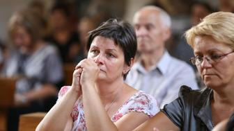 Inhabitants prays in local church in Vrpolje on August 12, 2015, after hearing in the news that Islamic State group claims to have beheaded Croatian hostage Tomislav Salopek, 31 years old, working for French geoscience company CGG and abducted last month west of Cairo. Prime Croatian Minister Zoran Milanovic said on August 12 he was unable to confirm the death of a hostage that the Islamic State group claimed to have beheaded, but that he feared the worst. TThe Islamic State group posted a purported picture of the victim's body on IS-affiliated Twitter accounts. AFP PHOTO /STRINGER        (Photo credit should read STRINGER/AFP/Getty Images)