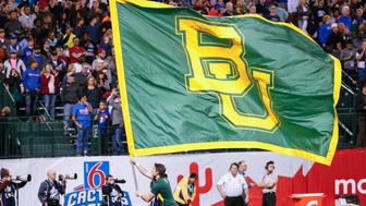 PHOENIX, AZ - DECEMBER 27:  The Baylor Bears flag is brought onto the field before the Motel 6 Cactus Bowl college football game between the Boise State Broncos and the Baylor Bears on December 27, 2016 at Chase Field in Phoenix, Arizona. (Photo by Kevin Abele/Icon Sportswire via Getty Images)