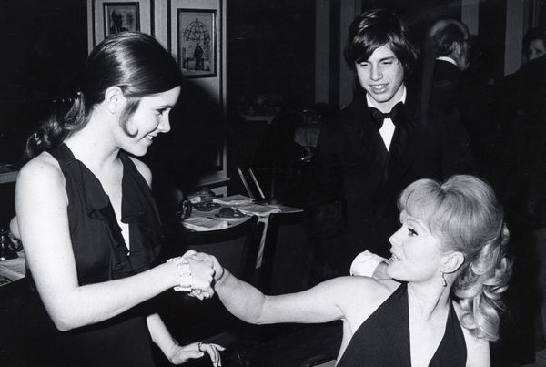 "Carrie Fisher, Todd Fisher and Debbie Reynolds at the opening of ""Irene"" on March 13,1973, at Minskoff Theater in New York Ci"