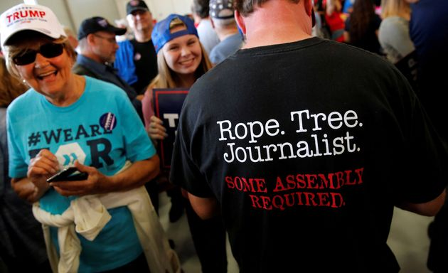 A man at a Trump rally in Minneapolis sports a shirt suggesting journalists should be hanged, Nov. 6,