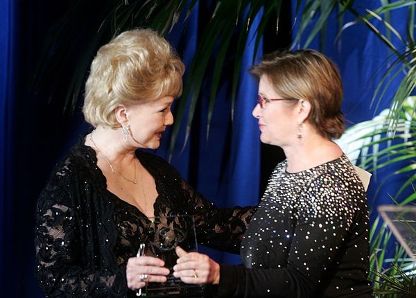 Carrie Fisher gives the Lacoste Presidents Award to her mother at the 2005 Costume Designers Guild Awards at the Beverly Hilt