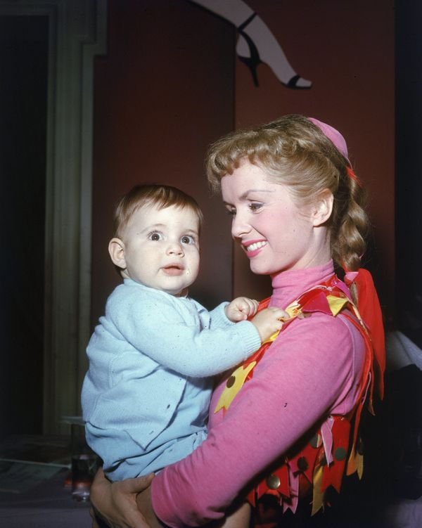 Reynolds holds her infant daughter.