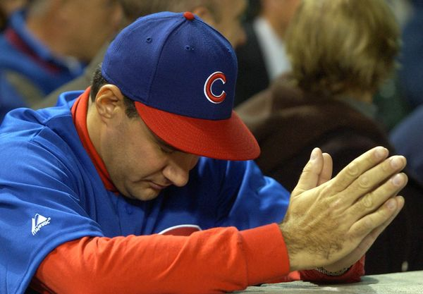 CHICAGO - OCTOBER 15:  An fan waits for the final outs between the Florida Marlins and the Chicago Cubs during game seven of