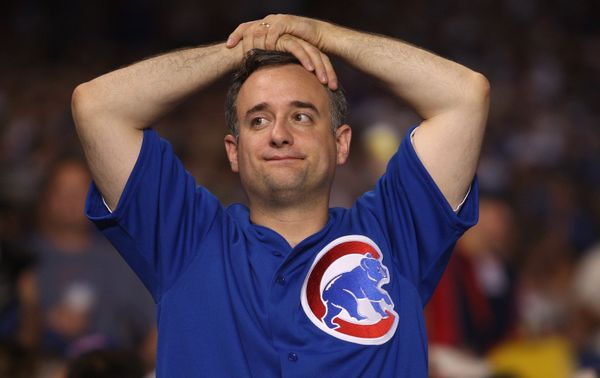 CHICAGO - OCTOBER 06:  A fan of the Chicago Cubs looks on dejected against the Arizona Diamondbacks during Game Three of the