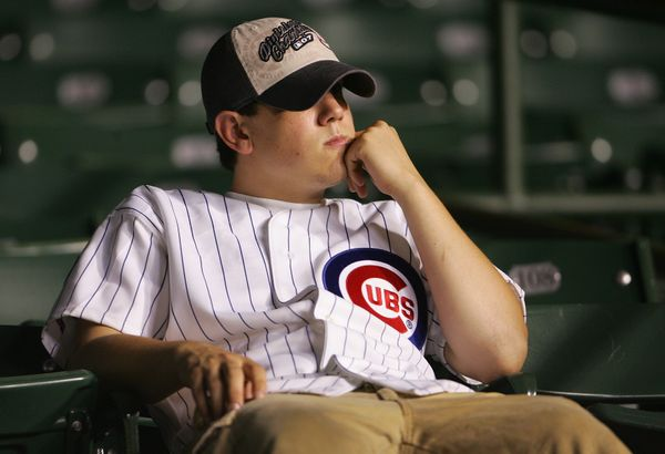 CHICAGO - OCTOBER 06:  A fan of the Chicago Cubs sits in the stands dejected after the Cubs lost 5-1 against the Arizona Diam