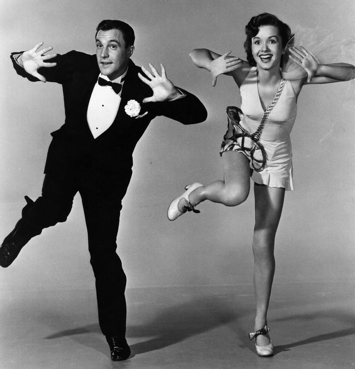 """American actor-dancer Gene Kelly rehearsing with Debbie Reynolds for the MGM musical """"Singin' in the Rain,""""directed by"""